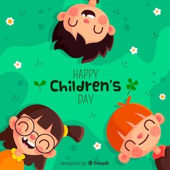 Schöne Kindertagskomposition mit flachem Design