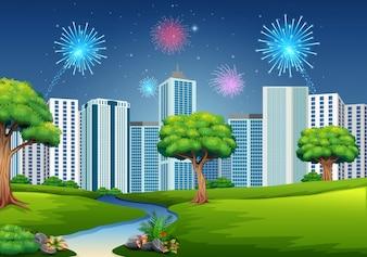 Schöner Garten mit Stadtbildgebäude und Feuerwerk