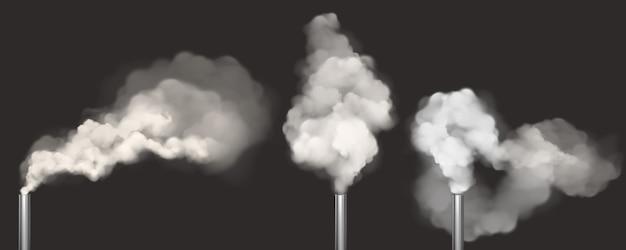 Schornsteine mit rauch, rohre mit weißem dampfgarnitur
