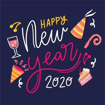 Schriftzug frohes neues jahr 2020 mit partyhut und lebensmitteln