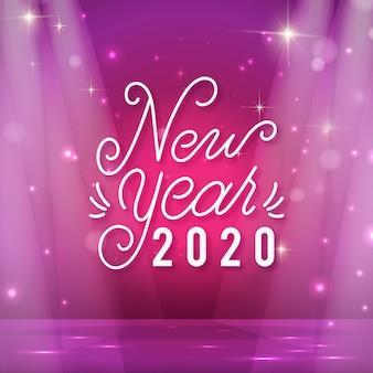 Schriftzug frohes neues jahr 2020 mit realistischer dekoration
