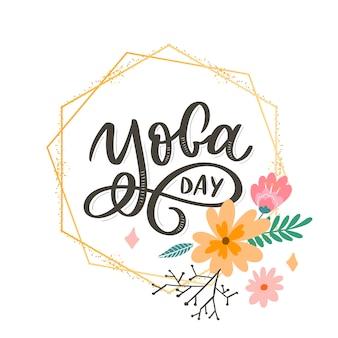 Schriftzug yoga day mit blumenrahmen