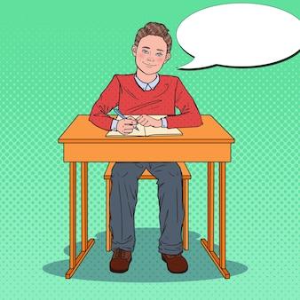 Schüler sitzt am schulschalter