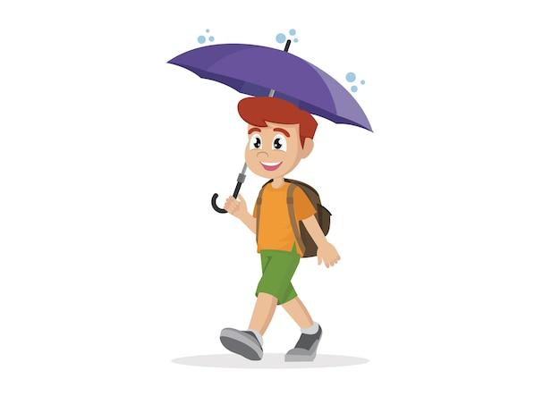 Schuljunge mit regenschirm im regen.