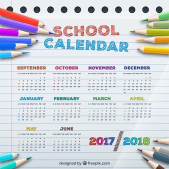 Schulkalender mit buntstiften im realistischen stil