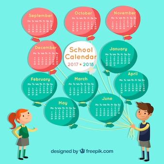 Schulkalender von mädchen und jungen mit ballons