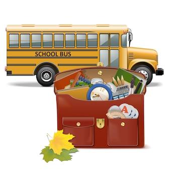 Schulranzen und bus isoliert auf weißem hintergrund