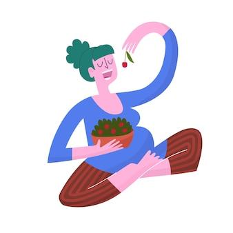 Schwangere frau, die kirschen isst. flach süß