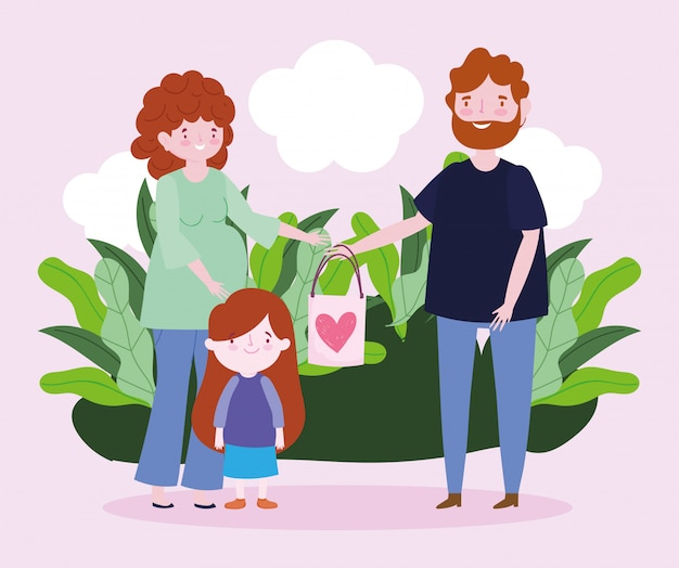 Schwangere frau vater und kleine tochter mit geschenktüte schön im park