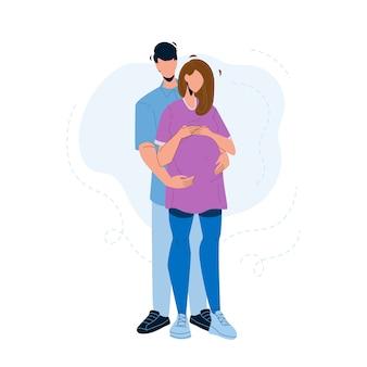 Schwangere paare, die junge familie umarmen