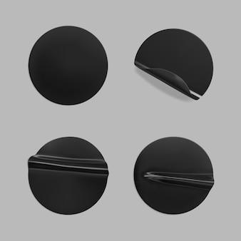 Schwarz geklebter runder zerknitterter aufkleber