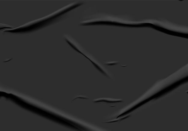 Schwarz geklebtes papier mit nassem falteneffekt. schwarze nasse papierplakatschablone mit zerknitterter textur. realistisches plakatmodell