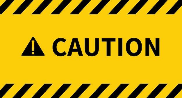 Schwarz-gelbe linie gestreiftes warnband warn- und gefahrenzeichen auf gelbem hintergrund