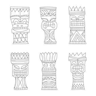 Schwarz-weiße polynesische tiki-idole aus holz, schnitzerei der götterstatue
