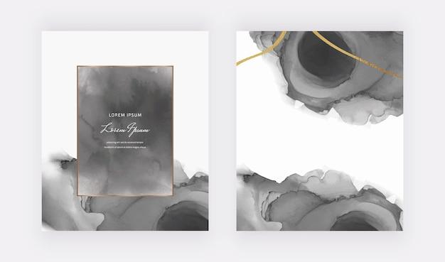 Schwarze aquarellkarten mit geometrischen rahmen und goldenen glitzerlinien