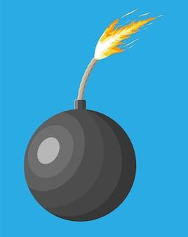 Schwarze ballbombe kurz vor der explosion. metallkreisbombe mit brennendem docht kurz vor der explosion.