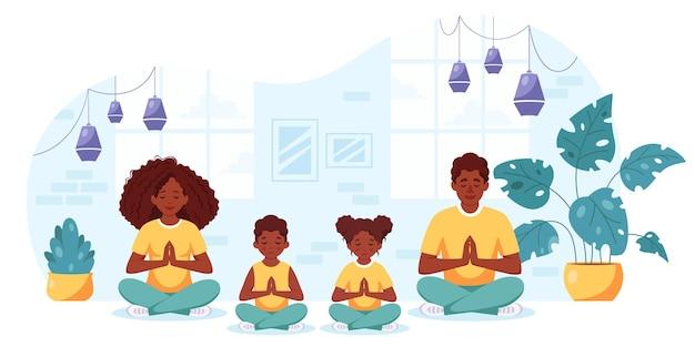 Schwarze familie macht yoga im gemütlichen interieur familie verbringt zeit zusammen