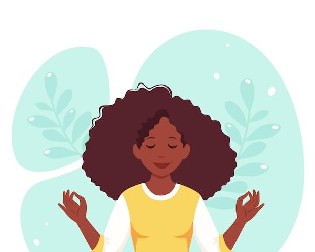 Schwarze frau meditiert. gesunder lebensstil