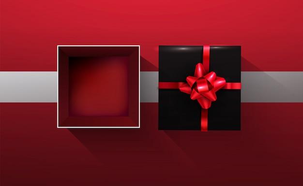 Schwarze geschenkbox des vektors 3d offen auf rotem und schwarzem boden