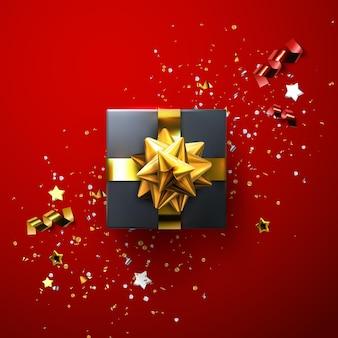 Schwarze geschenkbox mit glänzender goldener schleife und bändern mit funkelndem konfetti