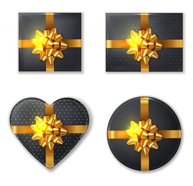 Schwarze geschenkbox und goldener bogen
