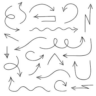 Schwarze gezeichnete art der pfeilikonen in der hand