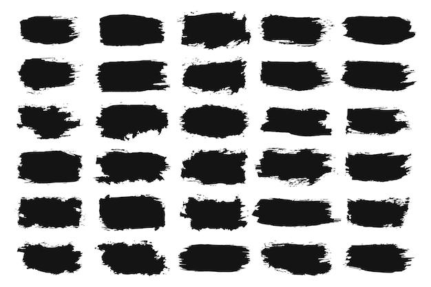 Schwarze handgemalte grunge-pinselstrich-sammlung Premium Vektoren