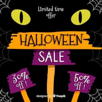 Schwarze katze mit halloween-verkauf der gelben augen