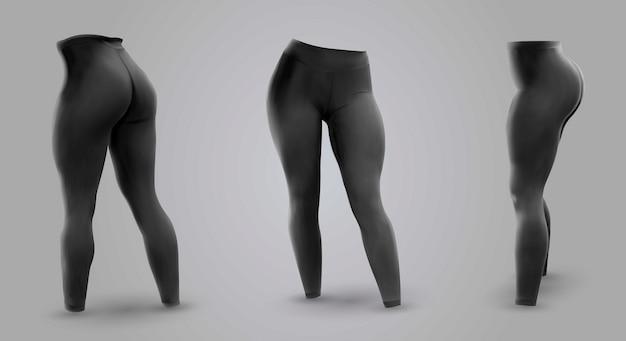 Schwarze leggings der frauen lokalisiert auf einem grauen hintergrund.
