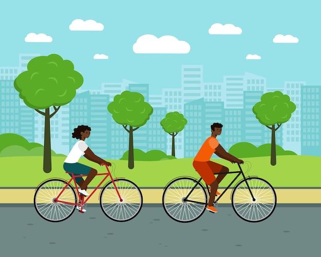 Schwarze leute fahren stadtfahrradfrau und -mann auf fahrrädern afroamerikanisches paar