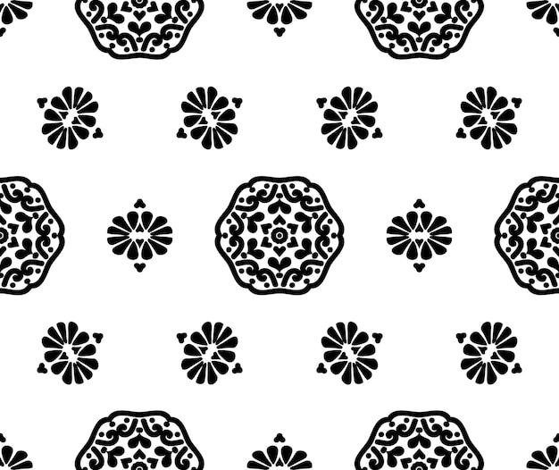 Schwarze mandala und blumen auf weißem hintergrund abstraktes nahtloses blumenmusterdekorative textur