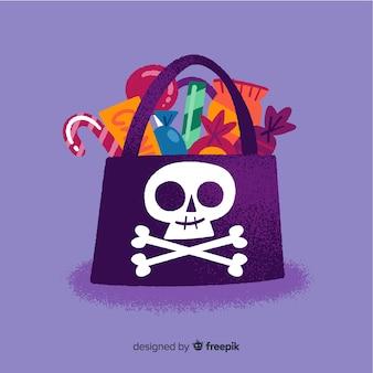Schwarze piratenschatz-schädeltasche mit süßigkeiten
