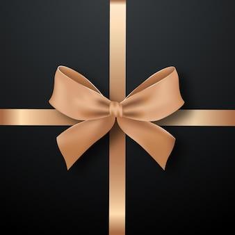 Schwarze quadratische geschenkbox verziert mit goldenem schleifenband
