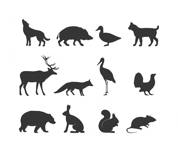 Schwarze silhouette der wilden tiere und symbole des wilden tieres