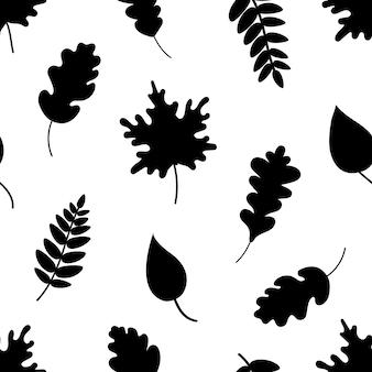 Schwarze silhouetten verschiedener blätter, die ein nahtloses muster auf schwarzem hintergrund bilden