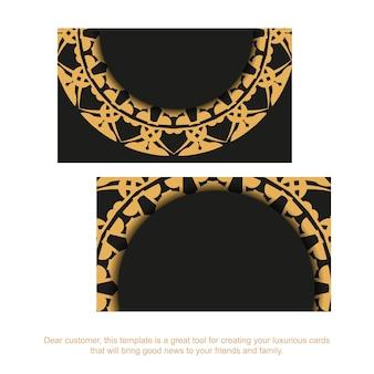 Schwarze visitenkarte mit braunem griechischem muster