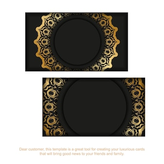 Schwarze visitenkarte mit goldenem indischem muster