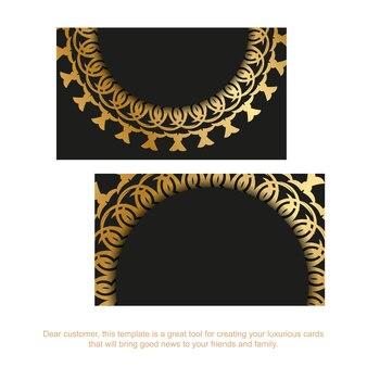 Schwarze visitenkarte mit goldenem mandala-ornament