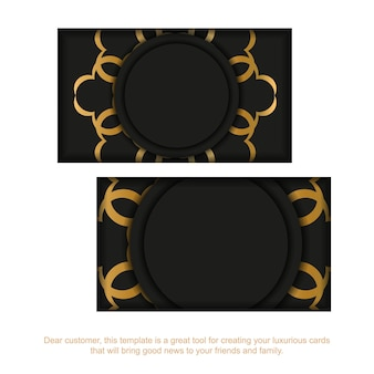 Schwarze visitenkarte mit goldenem vintage-muster