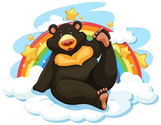 Schwarzer bär auf der wolke mit regenbogen