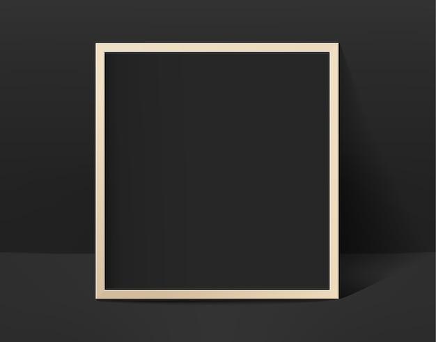 Schwarzer fotorahmen im schwarzen innenraum
