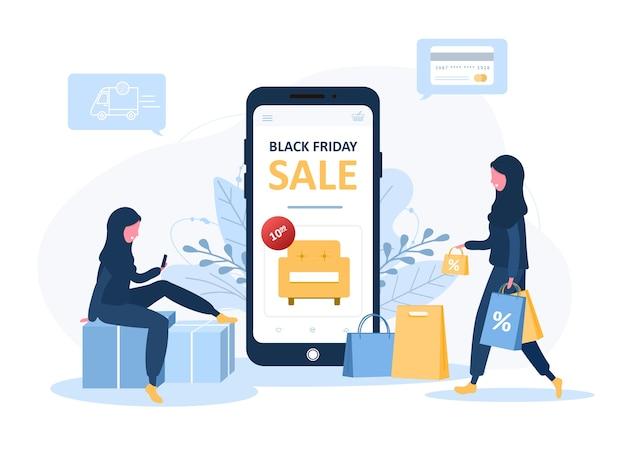 Schwarzer freitag verkauf. arabische frauen kaufen in einem online-shop ein, der auf kisten sitzt. der produktkatalog auf der webbrowserseite.