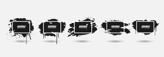 Schwarzer grunge-pinselstrich mit weißem rahmen.
