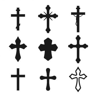 Schwarzer schattenbildsatz des christlichen kreuzes lokalisiert auf einem weißen hintergrund.
