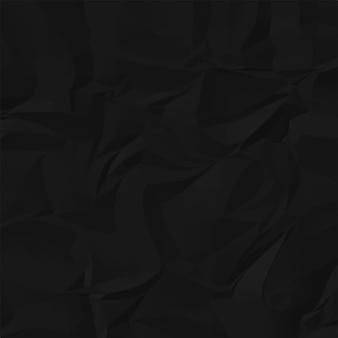 Schwarzer zerknitterter papierhintergrund.