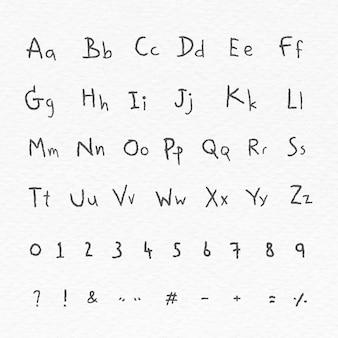 Schwarzes alphabet und zahlensatz auf einem weißen papier