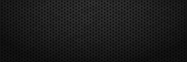 Schwarzes eisenblech mit sechseckigen ausschnitten hintergrund metallische kohlenstoffzahnräder