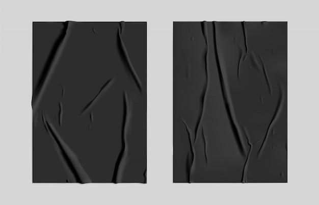 Schwarzes geklebtes papier eingestellt mit nassem falteneffekt auf grauem hintergrund.