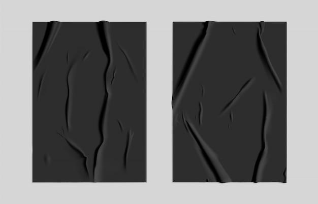 Schwarzes geklebtes papier mit feuchtem falteneffekt. schwarzes nasses papierplakatschablonenset mit zerknitterter textur. realistisches vektorplakatmodell