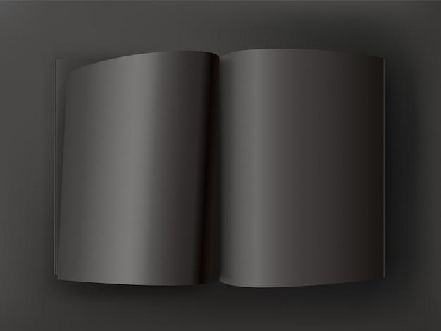 Schwarzes offenes buch auf dunkler tabelle